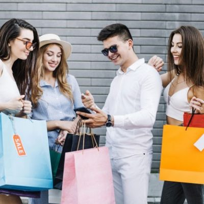 Group of shoppers with their smartphones